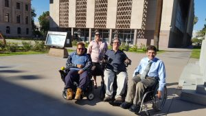YAC-AZ members George, Juliana, Calvin, and Jay are standing in front of House of Representatives in Arizona